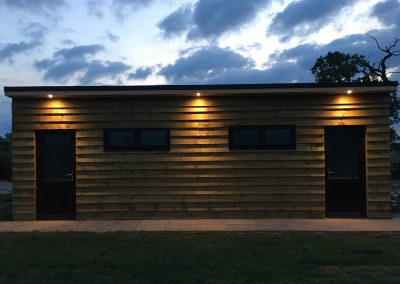 Pitch and Canvas | Glamping and Camping in Cheshire | Toilet block at night