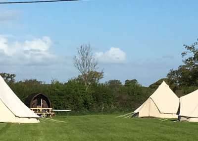 Pitch and Canvas | Glamping and Camping in Cheshire | Three Bell Tents in Field