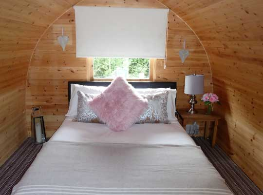 Pitch and Canvas | Glamping and Camping in Cheshire | Bed in luxury camping pods