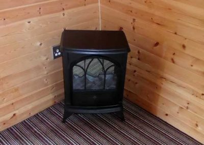Pitch and Canvas | Glamping and Camping in Cheshire | Electric fire in luxury pod